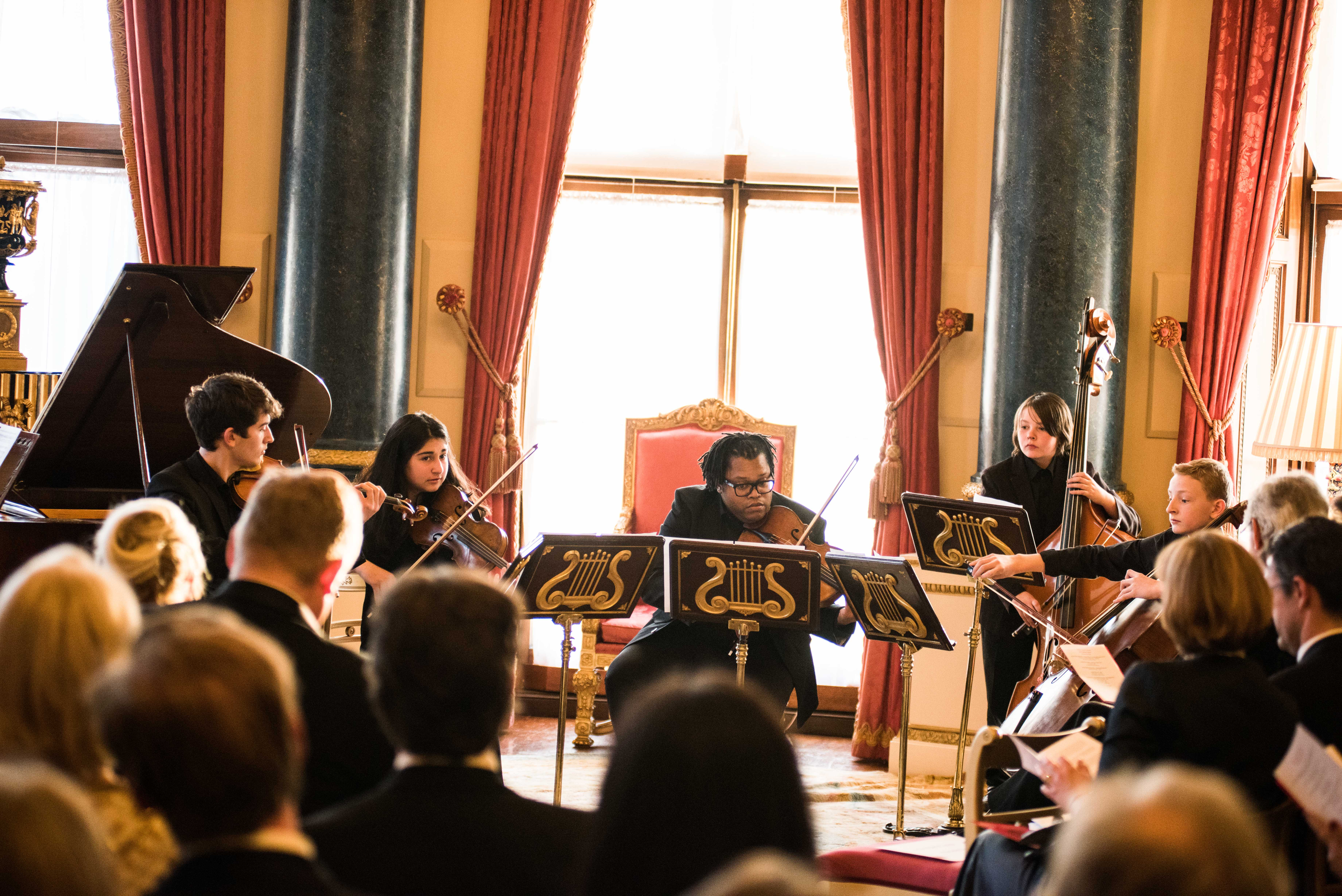 The string quintet performing