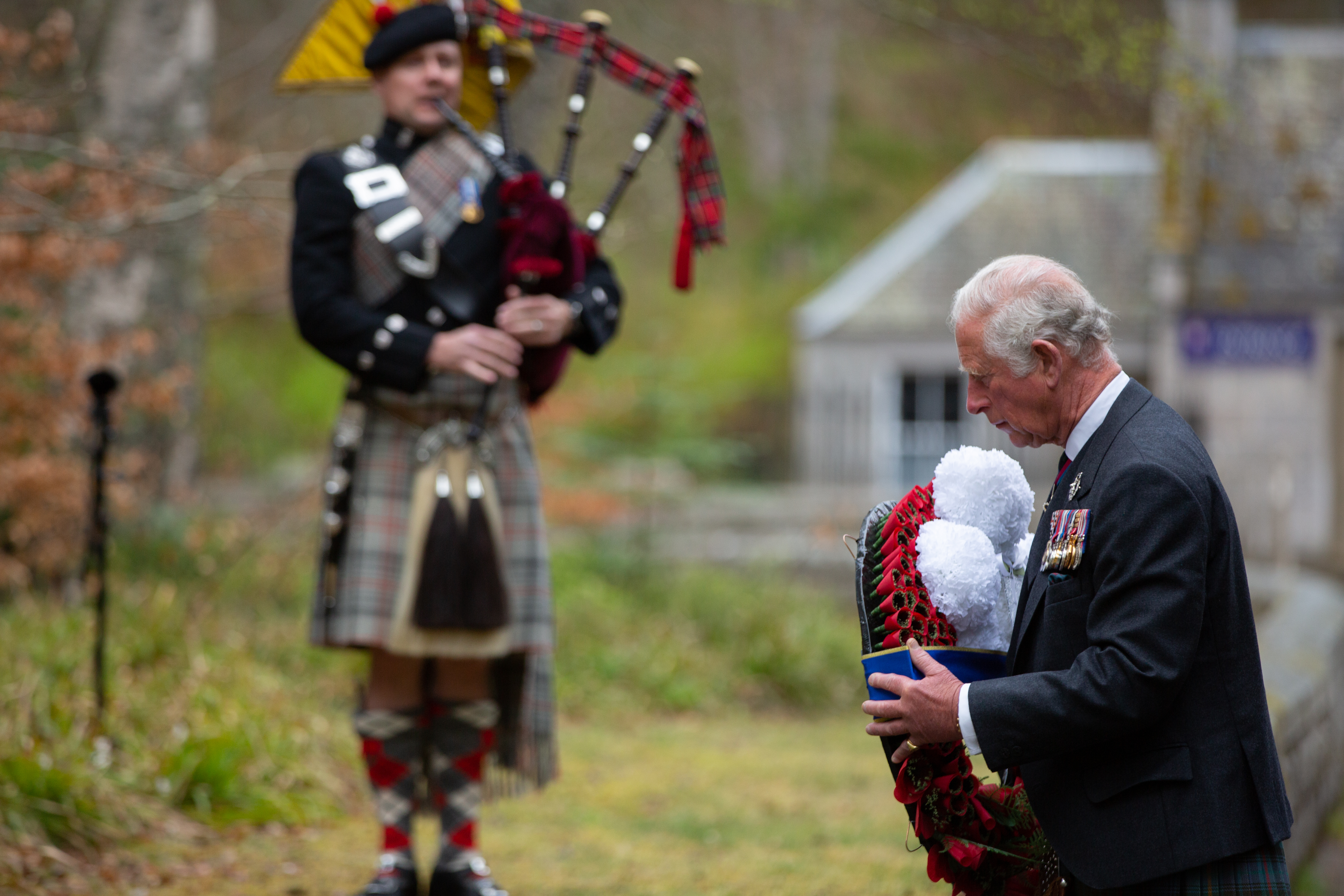 The Prince of Wales lays a wreath at the Balmoral Memorial, Aberdeenshire