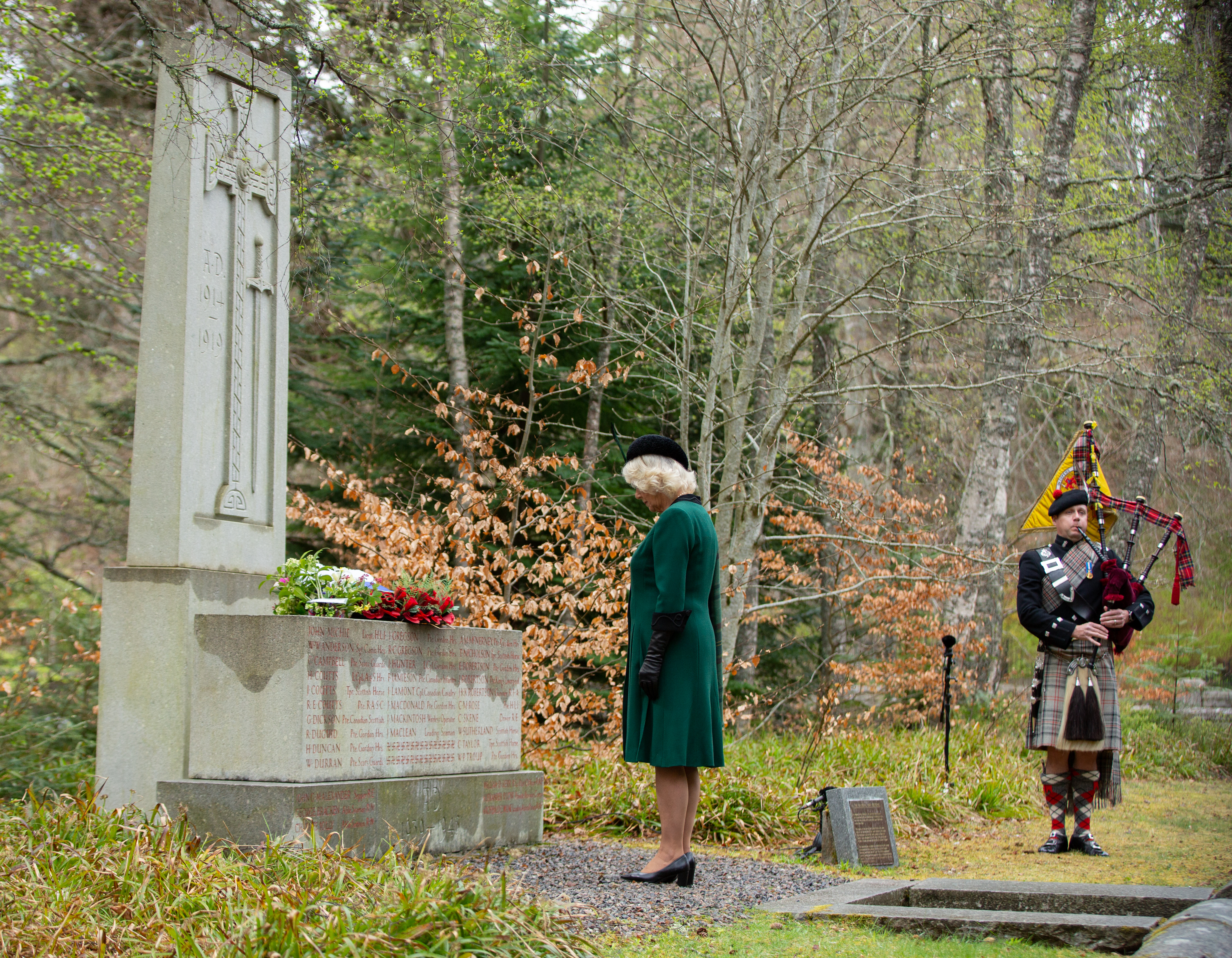 The Duchess of Cornwall lays flowers at the Balmoral War Memorial on VE Day