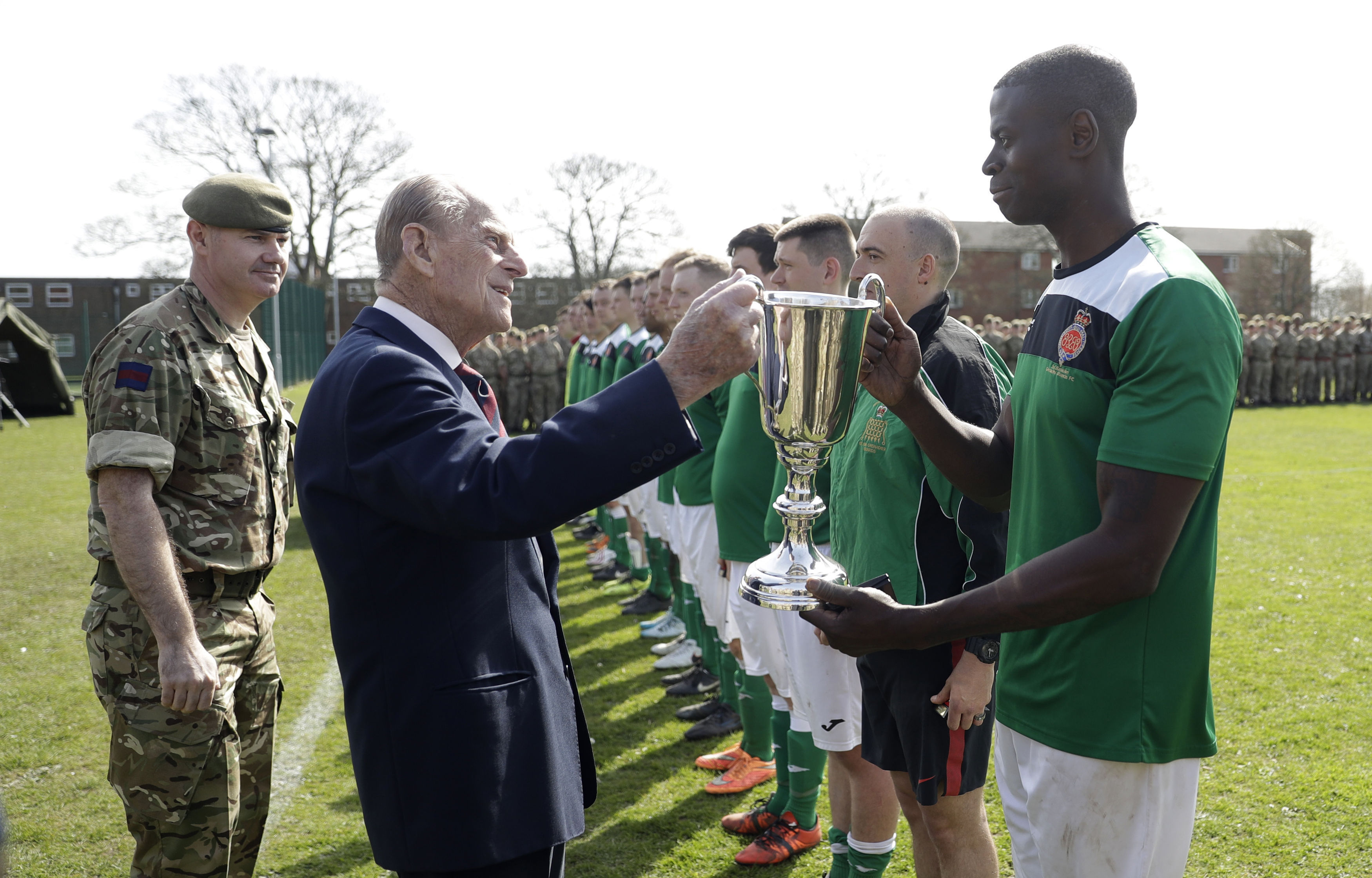 The Duke of Edinburgh presents the Manchester Cup to the Support Company
