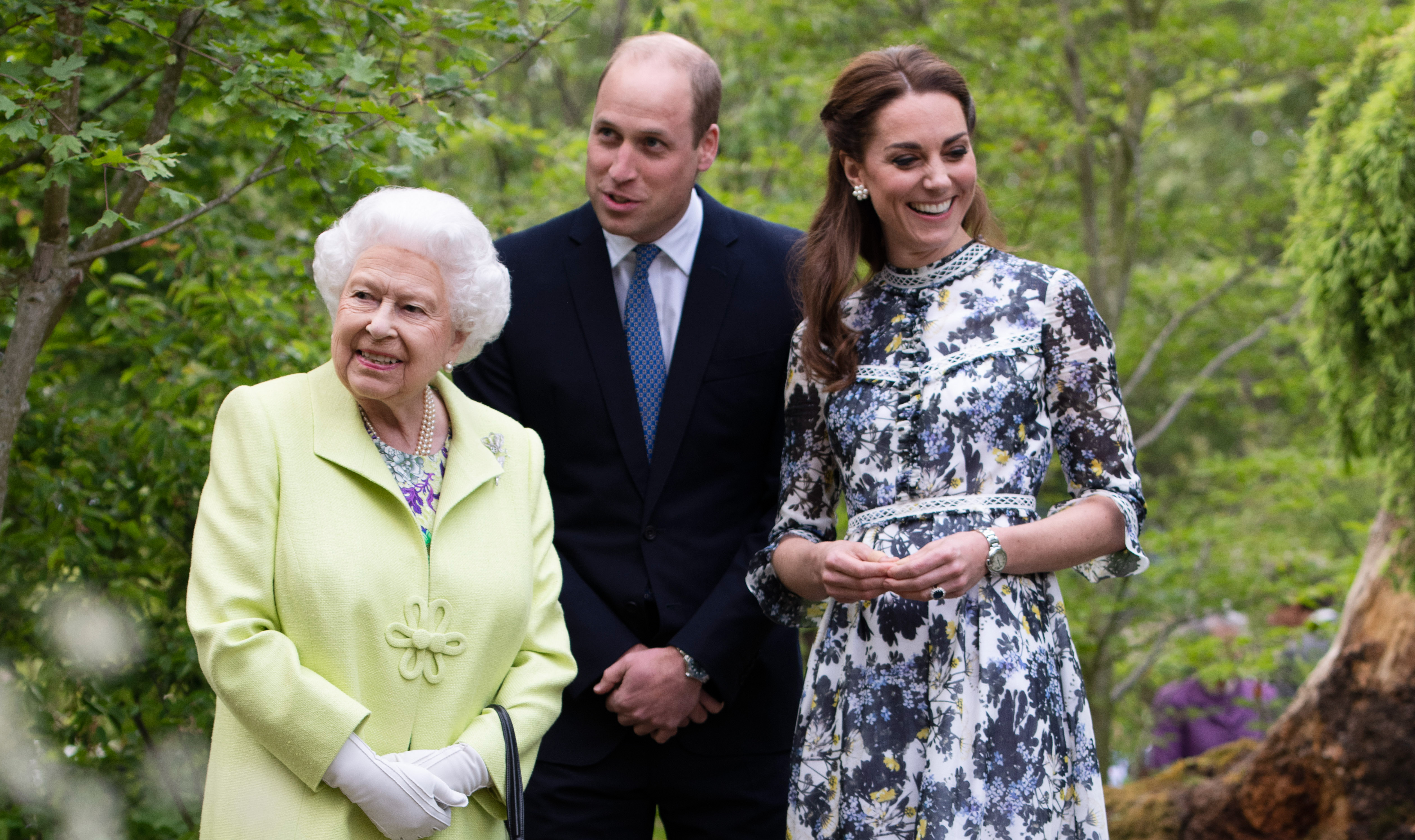 The Queen with The Duke and Duchess of Cambridge in the RHS Back to Nature Garden at the Chelsea Flower Show