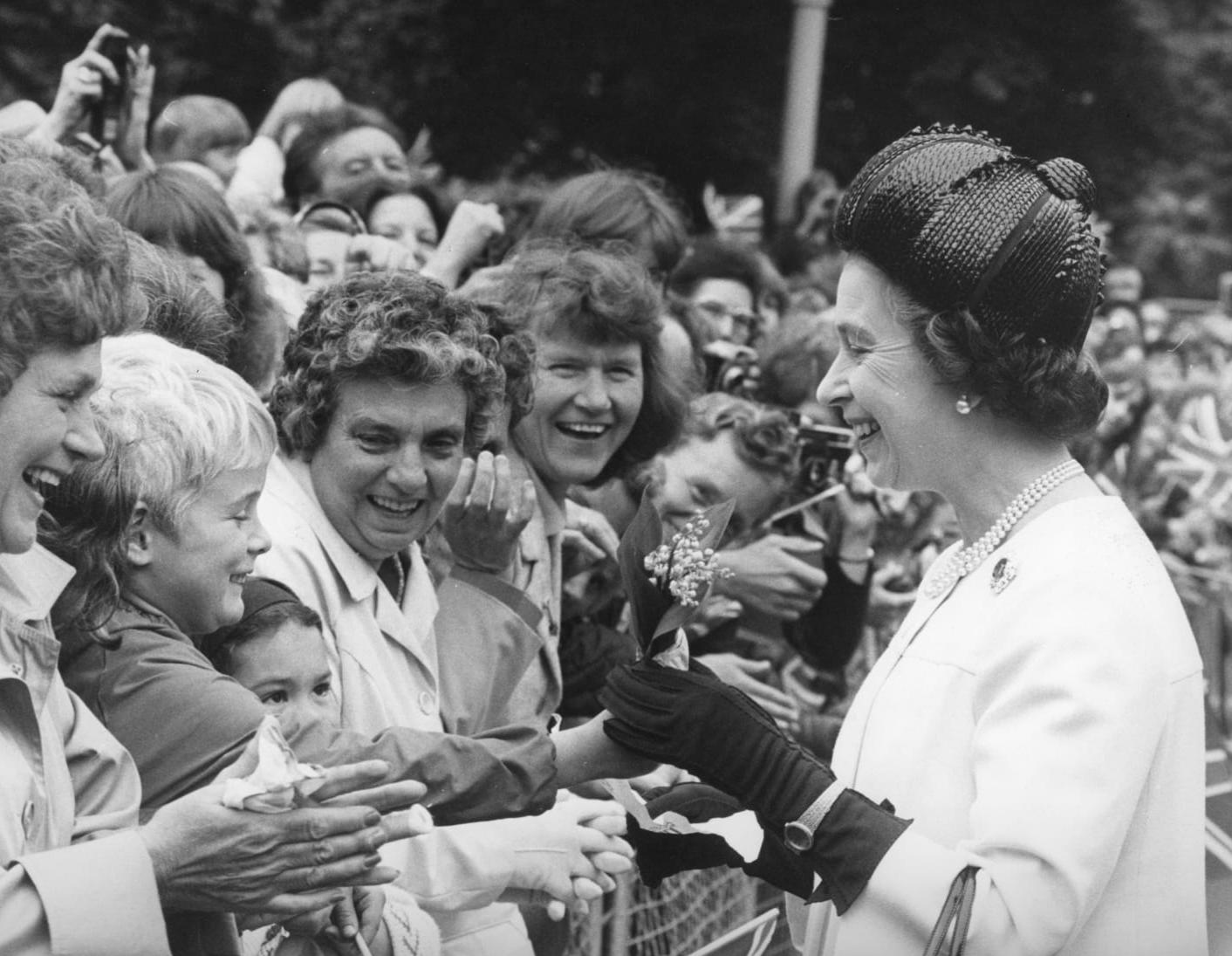 The Queen receives a lily of the valley posy