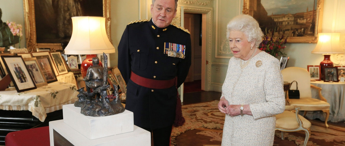 """The Queen receives amaquette of a statue of CanadianLt. Col. John McCrae,best known for writing the famous war memorial poem """"In Flanders Fields""""."""